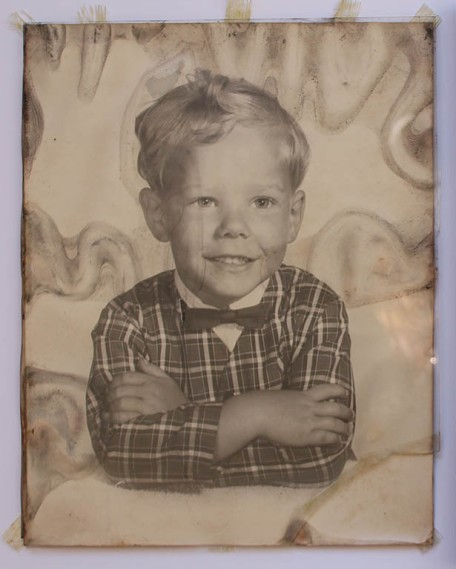 Storm damaged vintage portrait photograph
