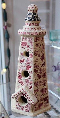 Vintage Delft Mosaic Lighthouse Birdhouse by Maira Fowler. Maira hand crafts these lovely indoor/outdoor decorative birdhouses. She lives with her two children and her mother, she is self-taught, and she is passionate about repurposing and recycling.
