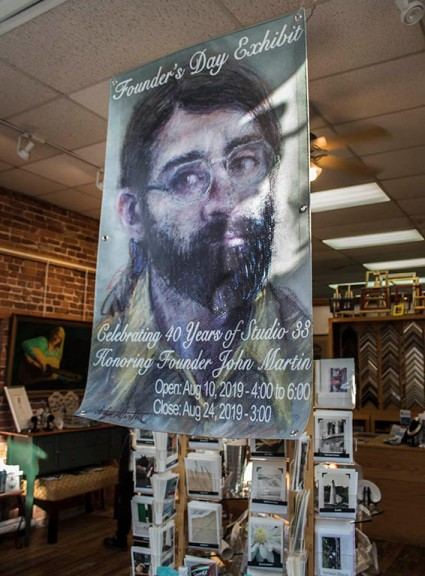 Poster of Exhibit Announcement featuring a pastel self portrait of John Martin